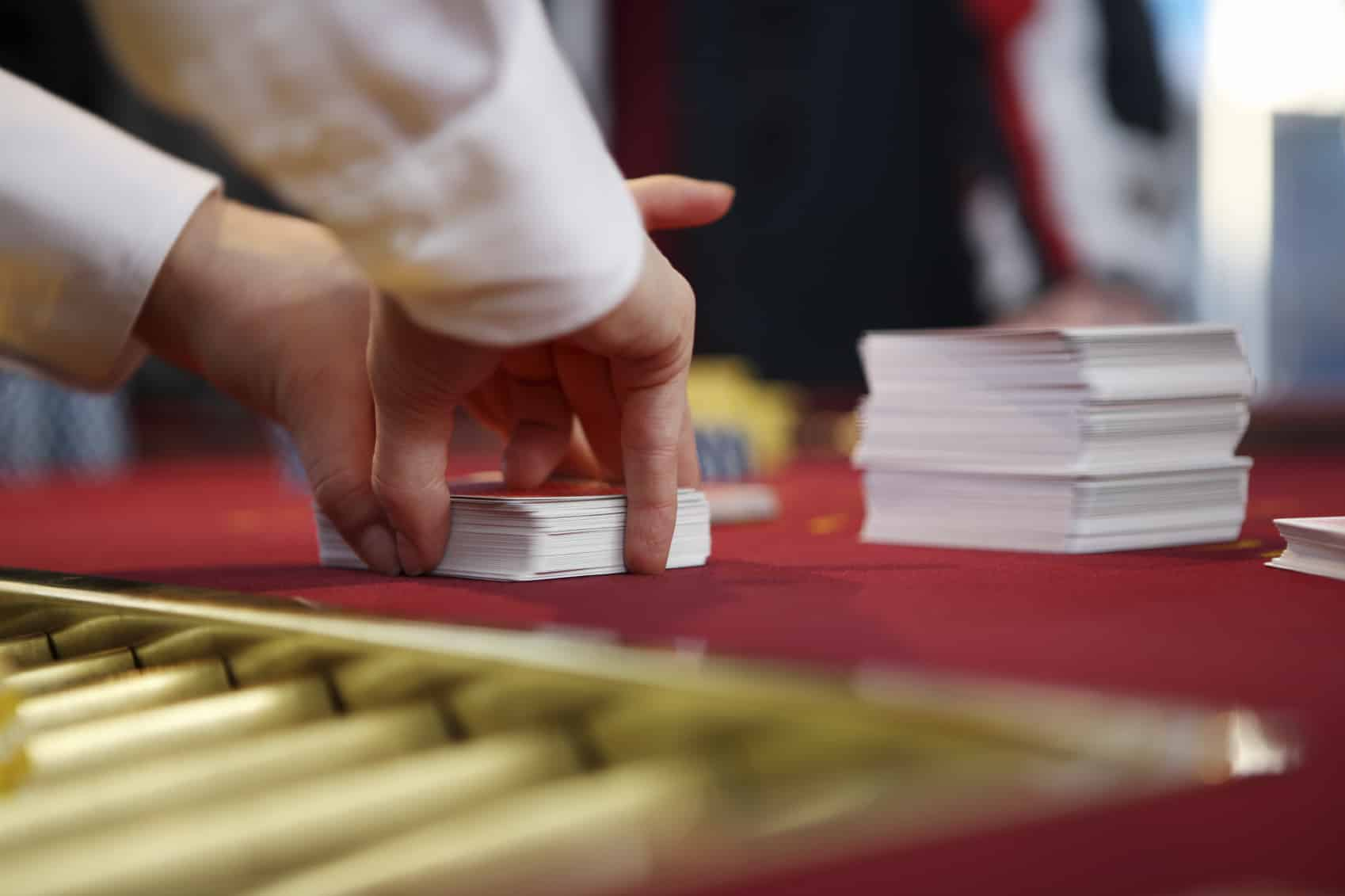 Shuffling cards, animated picture. Dealers' hands move fast, shuffle tracking is not an easy money scheme.