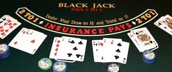 The picture is a screenshot of a realistic looking, high definition online Blackjack game. The screenshot depicts the casino table with Blackjack cards and casino chips; an online Blackjack game in session. The picture acts as a link and by clicking on the picture you will be take to the free Blackjack section, where you can play Blackjack for free.