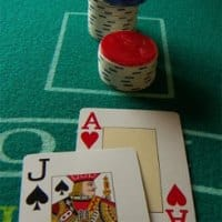 A professional gambler counting cards. Card counting is one of the advantage gambling methods.