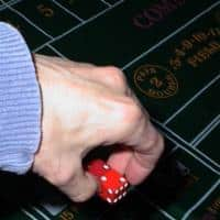A man trying to do a controlled shooting by using the advantage gambling method dice control.