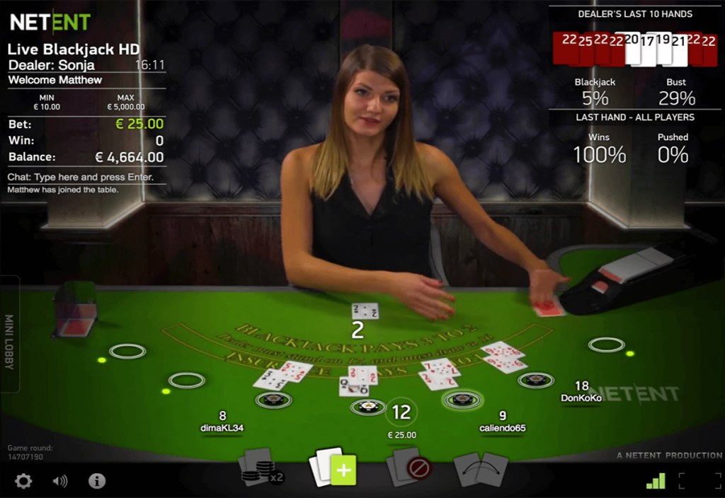 The picture shows a live blackjack dealer in Netent's 2019 Live Casino. You can read about the features and how to play the game under this picture and above this picture you can play the game with demo credits if a dealer is available.