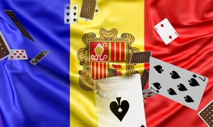 This is a picture of an Andorran flag with casino chips and playing cards in the foreground. On this page oyu can read about the laws and legislation affecting, regualting gambling and online gambling in the country.
