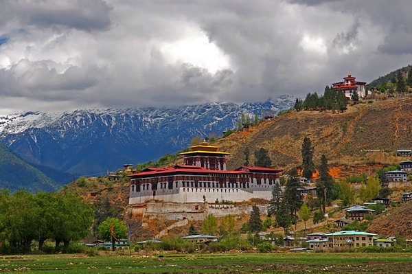 On the picture you can see a classic example of Dzong architecture in Paro Valley, Bhutan.