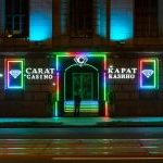 This is a picture of the outside of the building of Carat Casino, at night, in Minsk, in Belarus. To the right of the picture you can read more about this particular casino.
