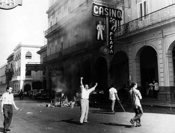 This is a picture of people in front of the last known casino in Cuba, Plaza Hotel and Casino. This is the header image of my Cuba gambling guide.