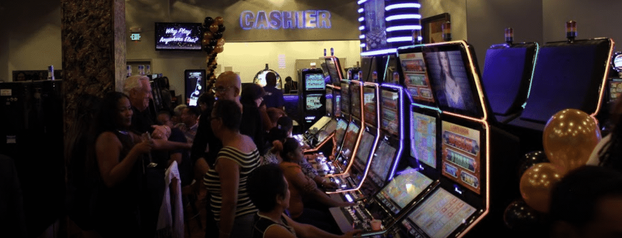 This is a picture of the inside of Royal Caribbean Club Casino, in Port of Spain, the capital of the Republic of Trinidad and Tobago. On this page, you can read about the legislation, rules, licensing, taxation of of the various forms of games of chance and online gambling on the islands in Trinidad & Tobago, including: poker, bingo, lottery, sports betting, cryptocurrency wagering, and a list of online gambling sites which accept players from the island country.