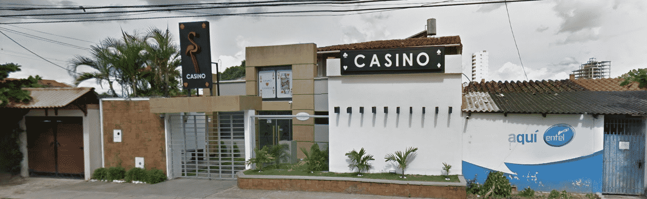 This is a picture of Flamingo Casino, a gambling establishments in Santa Cruz de la Sierra, a bigger city in the Plurinational State of Bolivia. On this page, you can read about the legislation, rules, licensing, taxation of of the various forms of games of chance and online gambling in the country, including: poker, bingo, lottery, sports betting, cryptocurrency wagering, and a list of online gambling sites which accept players from Bolivia.