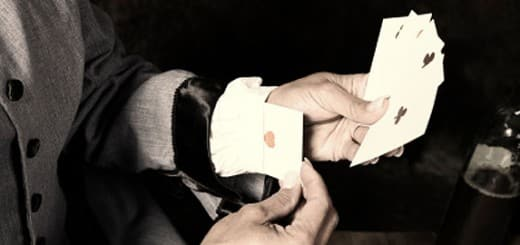 On the picture is a cheat performing card mucking - cheating at Poker with this method is effective