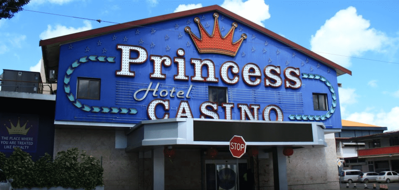 This is a picture of the front entrance of Princess Hotel and Casino in Suriname. On this page you can read about the legislation, rules, licensing, taxation of the various forms of games of chance and online gambling in Suriname, including: poker, bingo, lottery, sports betting, cryptocurrency wagering, and a list of online gambling sites which accept players from the country.