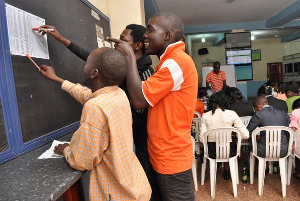 People placing bets at a bookmaker in Uganda. Sports betting is the most popular form of gambling in Uganda.