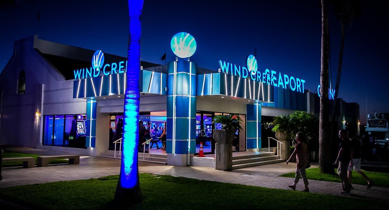 This is a picture of Wind Creek Seaport Casino, taken at night, this is one of the gaming venues in Aruba. On this page you can read about the legal status of gambling, online gambling, bingo, poker, sports betting, lottery, bitcoin, cryptocurrency gambling, casino gambling in Aruba + a list of licensed online gambling websites that accept players from the country.