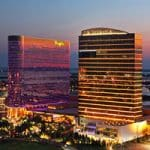 This is a picture of the building of Borgata Hotel Casino and Spa which is the biggest land-based non-profit casino in New Jersey. Next to the picture, you can read about the gambling establishments, the legal status of online casinos, crypto casinos and tribal casinos in NJ, taxation of winnings and legal gambling age in the state.