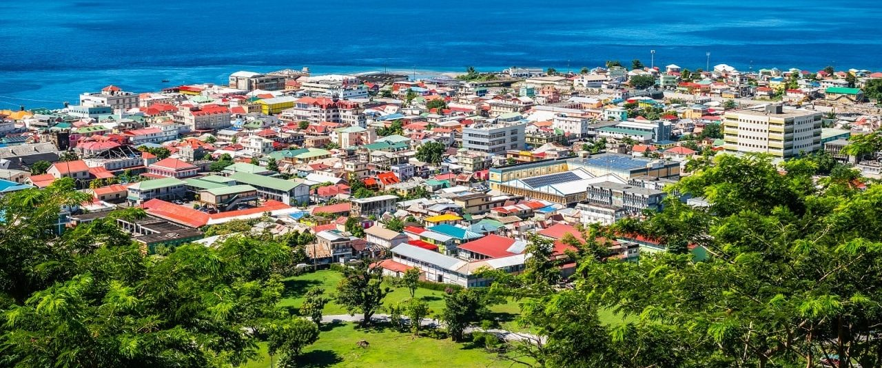 This is a picture of Roseau, the largest city and capital of Dominica, where the cruise ships with casinos stop, and where the Mapau Dominica Entertainment Centre Roseau is located, one of the two gambling establishments on the island. On this page you can read about the laws, regulations, taxation, licensing of bingo, poker, casino gambling, lottery, sports betting, internet wagering, cryptocurrency games of chance, and a list of online gambling websites licensed in Dominica is included too.