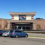 This is a picture of the main building of Dakota Magic Casino which is the biggest land-based Native American casino in North Dakota. Next to the picture, you can read about the gambling establishments, the legal status of online casinos, crypto casinos and tribal casinos in ND, taxation of winnings and legal gambling age in the state.
