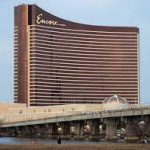 This is a picture of the building of Encore Boston Harbor, which contains the biggest land-based casino in Massachusetts. Next to the picture you can read about the gambling establishments, the legal status of online casinos, crypto casinos and tribal casinos in Massachusetts, and taxation of winnings, legal gambling age.