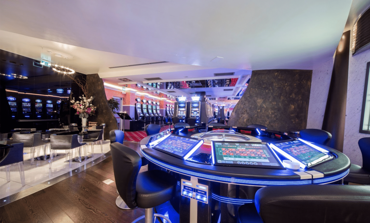 This is a picture of the interior of Giochi del Titano S.P.A, one of the two licensed land-based gambling establishments in San Marino. Under the picture you can read about San Marino gambling, online gambling, bitcoin games of chance legislation, laws, licenses, taxes in San Marino.