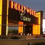 This is a picture of the front gate of Hollywood Casino Columbus which is the biggest land-based Native American casino in Ohio. Next to the picture, you can read about the gambling establishments, the legal status of online casinos, crypto casinos and tribal casinos in OH, taxation of winnings and legal gambling age in the state.