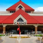 This is a picture of the cruise ship of Prairie Meadows Racetrack and Casino, which is Iowa's biggest racetrack + casino (a.k.a. racino) currently. Next to the picture you can read about the gambling establishments, the legal status of online casinos, crypto casinos and Indian casinos in Iowa, and taxation of winnings, legal gambling age.