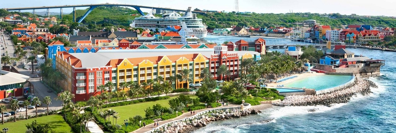 This is a picture of Renaissance Curacao Resort & Casino, in Willemstad, the capital of Curacao. On this page you can read about the legislation, laws, rules, taxation, licensing of the various forms of games of chance and online betting in Curaçao, these include: poker, bingo, casino gambling, cryptocurrency wagering, lottery.