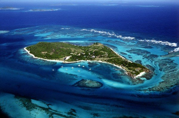 This is an aerial photograph of one of the islands of the St. vincent and the Grenadines. The island nation is famous for its lottery and casinos. you can read all about them below the picture.