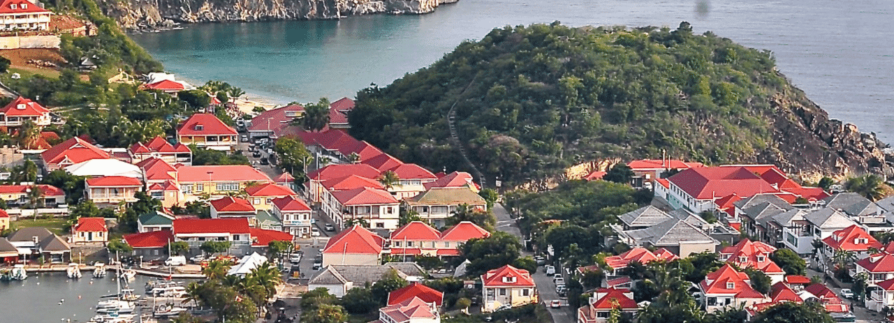 This is an aerial photograph (not drone, but from an airplane) of Gustavia, the capital and main port of the island nation of Saint-Barthélemy. On this page, you can read about the legislation, rules, licensing, taxation of of the various forms of games of chance and online gambling in the country, including: poker, bingo, lottery, sports betting, cryptocurrency wagering, and a list of online gambling sites which accept players from St. Barts.