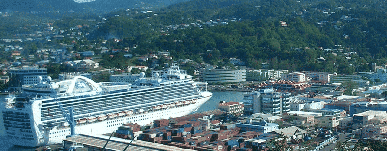 This is an aerial photograph (not drone, but from an airplane) of the port of Castries (with a huge cruise ship docked there), the capital of Sainte-Lucie. On this page, you can read about the legislation, rules, licensing, taxation of of the various forms of games of chance and online gambling in the country, including: poker, bingo, lottery, sports betting, cryptocurrency wagering, and a list of online gambling sites which accept players from St. Lucia.