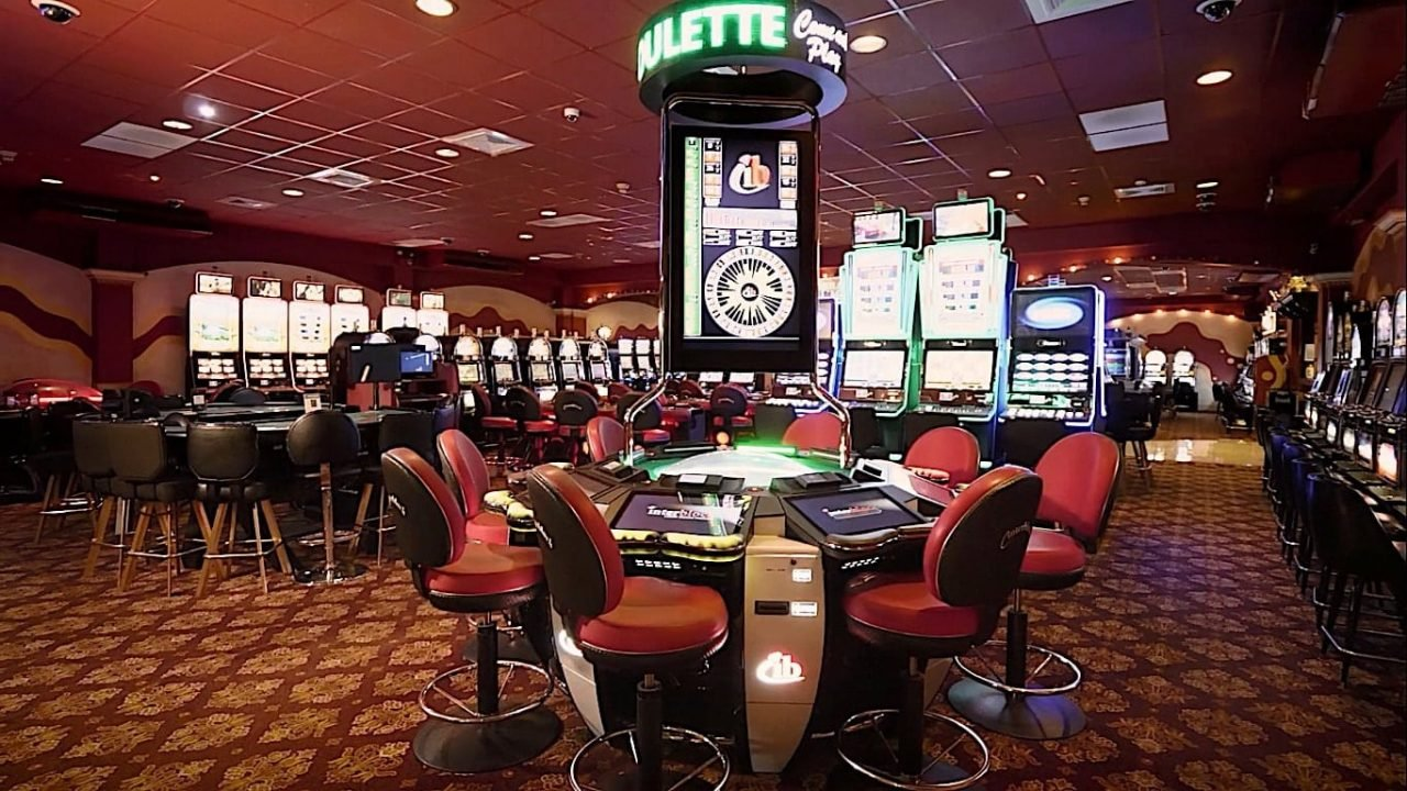 This is a picture of the inside of Monte Carlo Gaming Lounge within Terra Nova All Suite Hotel Jamaica, this is the country's biggest gambling establishment. On this page you can read about the legislation, taxation regime, licensing process of the various forms of online games of chance in Jamaica, including internet poker, digital sports betting, cryptocurrency wagering, internet lottery and electronic bingo.