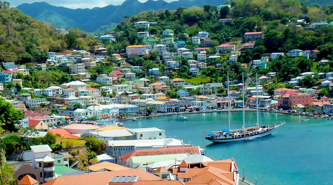 This is a picture of the port of St. George's, Grenada's capital city. On this page you can read about the recently legalized (since 2014) games of chance, online gambling, poker, sports betting, lottery, cryptocurrency wagering legislation, taxation and licensing process, and a list of online gambling sites, which accept players from the country can also be found below the picture.