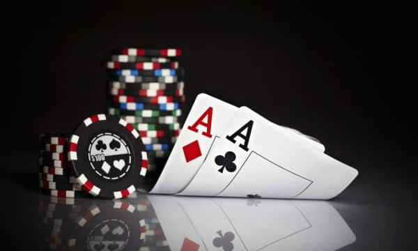 This an image of chips and cards representing poker bonuses. This is the header image of my online poker bonus guide.