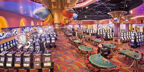 This is a phot of the interior of the Casino Carnaval, the largest casino in Curacao, with gaming machines and tables visible. On this page, you can find information and a list of the best and biggest casinos, slot halls, electronic casinos on the island.