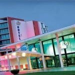 This is a picture of the Pasino Saint-Amand-les-Eaux hotel and casino complex in France. Right next to the picture you will find the name, address, number and type of games you can play in the casino.