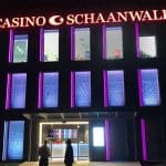 This is a picture of the building of Casino Schaanwald at night, with the entrance gate visible in Liechtenstein. You can read about this gambling establishment to the right of the picture.