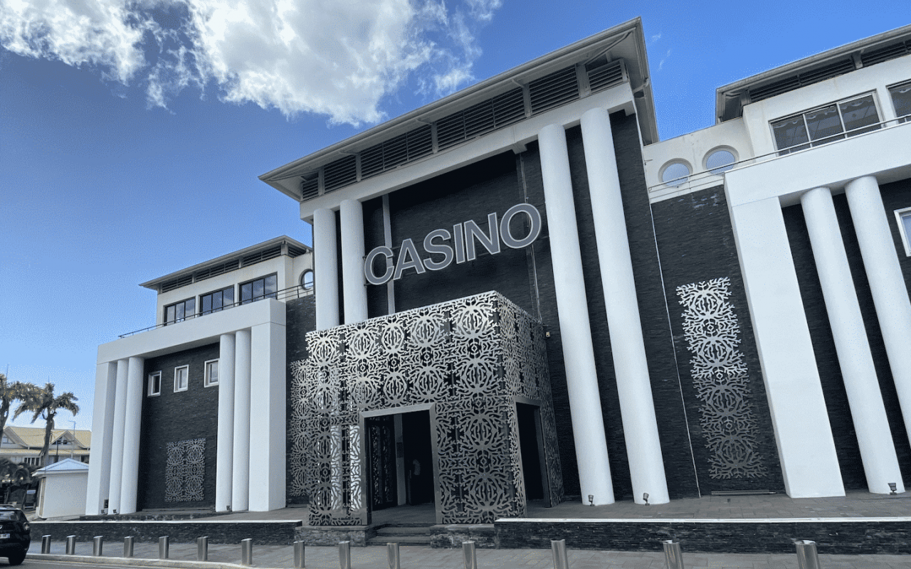This is a picture of the building, decorative facade, and front entrance of the Casino de Gosier in Guadeloupe, the largest casino in the region. On this page you can read about the taxation, legislation, licensing of casino gambling on the islands, and you can find a list of licensed casino gambling establishments, slot halls and online casinos, which accept players from the French overseas territory.