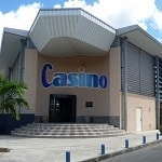 This is a photo of the front entrance of Casino des Trois-Ilets, during the day. This is the second and last element of this list of all 2 casino gambling establishments in Martinique. You can find the other gambling establishment on this list above this one. To the right of the picture, you can read more about this gaming venue.