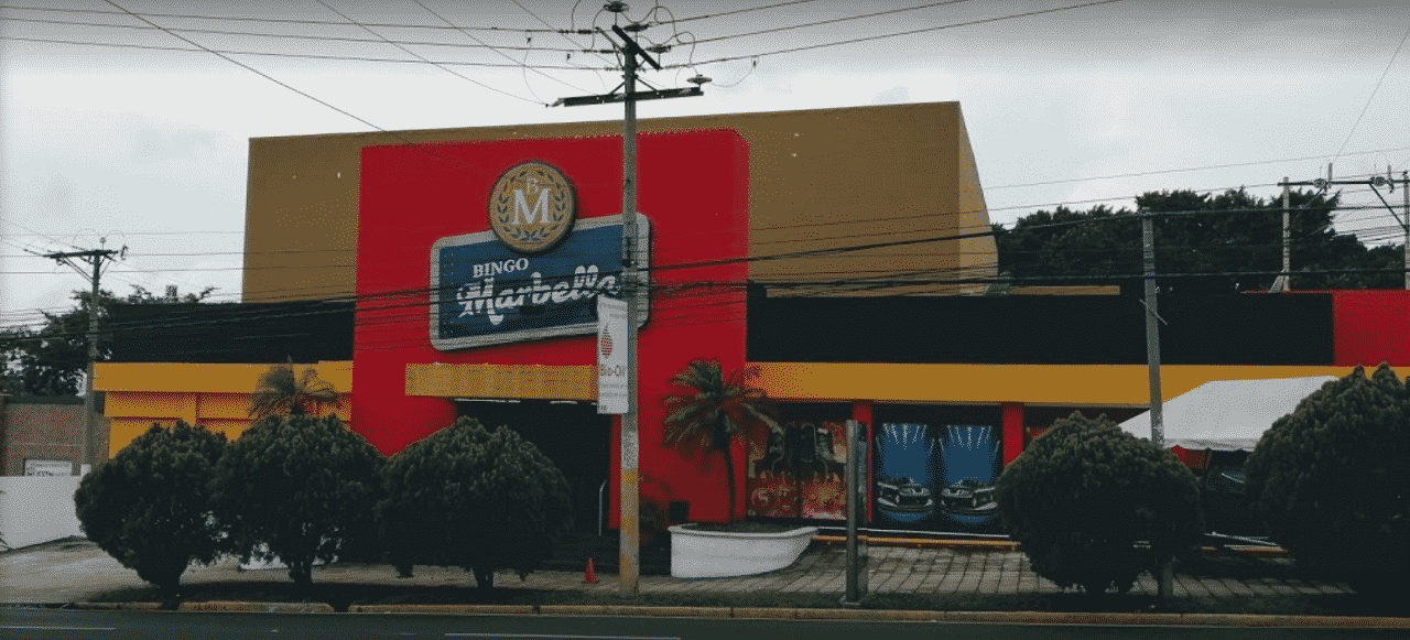 This is a picture of the main building and the front entrance of Bingo Marbella in San Salvador, in the capital of El Salvador. This gambling establishment is not actually a bingo hall, despite the name, this is a casino with table games and slots. On this page, you can read about casino gambling laws, licensing and taxation of online casinos, and you can find a list of Salvadorian casino gambling establishments and a list of online casinos, which accept players from the country.