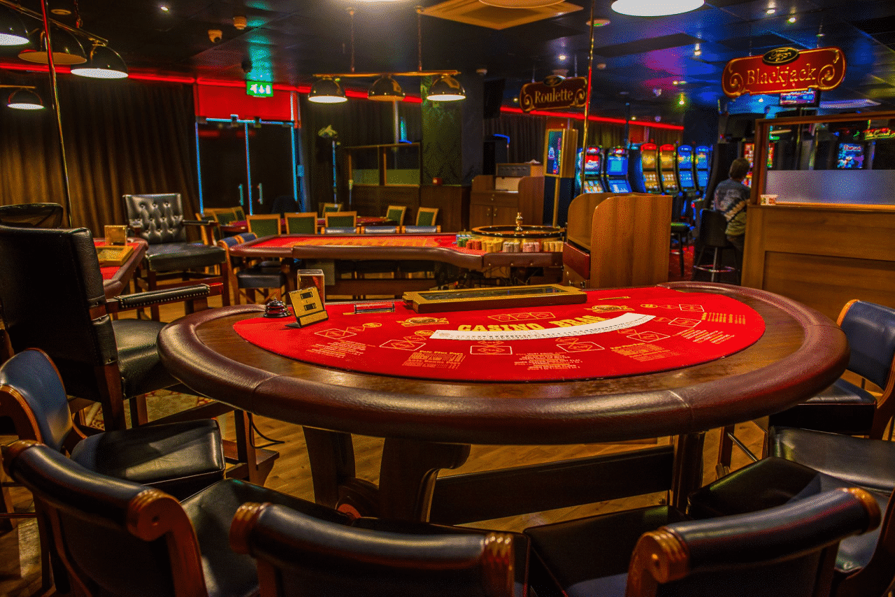 This is a photograph of the inside, the table games and live dealers section (that's a red blackjack/punto banco table without the dealer currently) of Fitzpatrick's Limerick City Casino, one of the biggest casino private club of Ireland and Fitzpatrick's is one of the biggest casino group in the country. On this page, under the picture you can read about casinos and online casinos and bitcoin gambling websites in Ireland + list of Irish casinos and online casinos which accept players from the country.