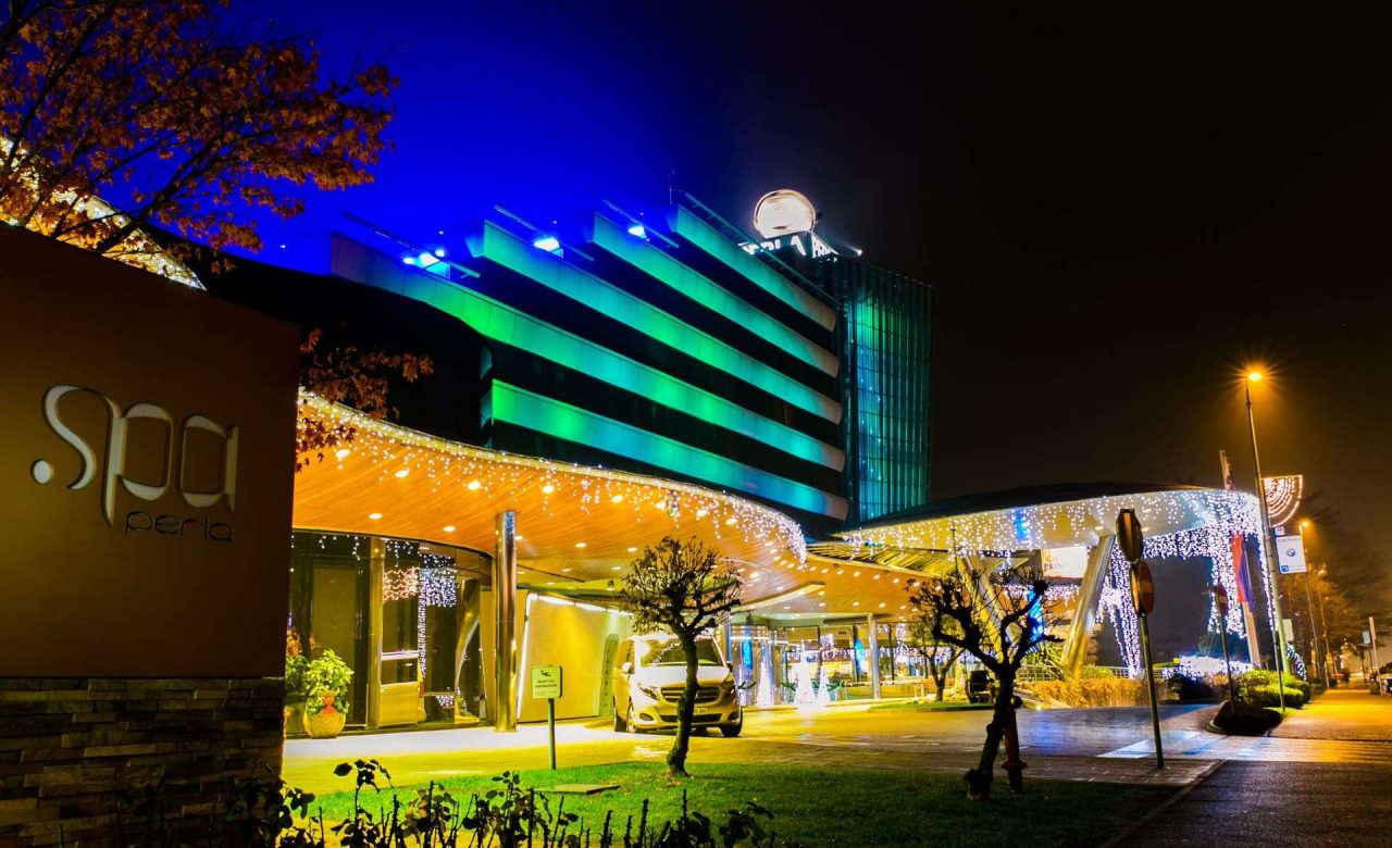 This is a photo of the building of Casino Perla, at night, from the outside, facing the front entrance gate. Casino Perla is Europe's biggest casino actually. Under the picture, you can read about Casino Perla, and you can find a list of all the other Slovenian casinos, and online casinos with a Slovenia gambling licence, which accept players from the country.