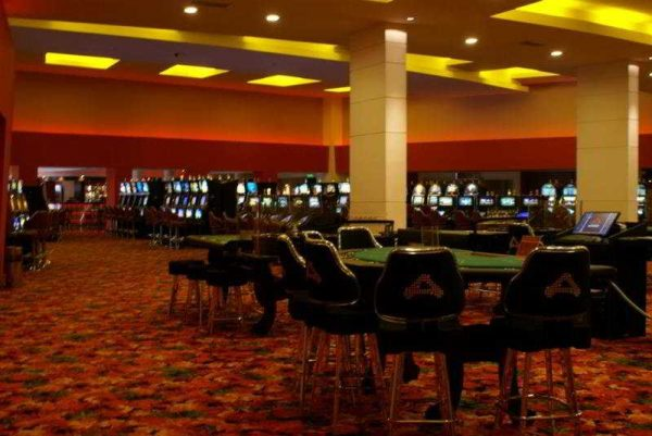 This is a photo of the interior of Hotel Casino Acaray, with gaming tables visible. On this page you can fin a list of the biggest and best Paraguay brick & mortar casinos, with address, opening hours, number and types of games, dress code, entrance fee, reviews and videos.