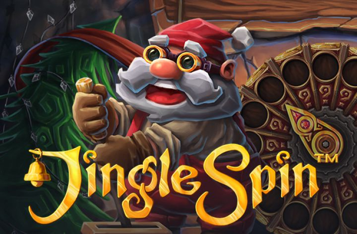 This is a screenshot for the game Jingle Spin, a 2018 digital fruit machine. It features Santa and the words Jingle Spin with Santa's toy making workshop in the background.