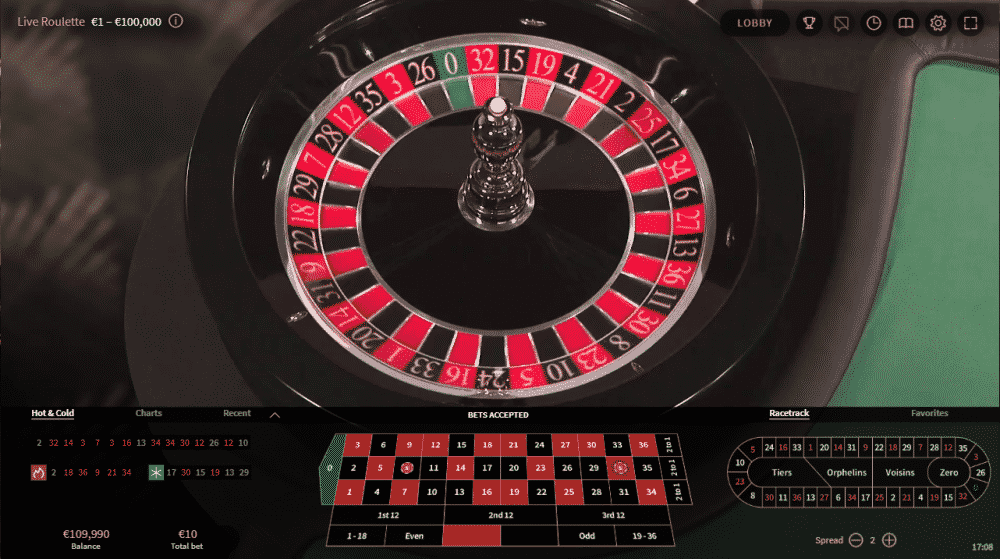 The picture shows you how a Live toulette table and wheel looks like in this live casino. The picture is the screenshot from the 2019 NetEnt (Live Beyond Live) Live Roulette platform. You can play the game on this webpage or read about the rules and other details of this gamlbing game under the picture.