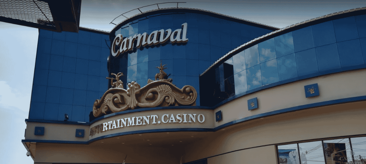 This is a picture of the front gate and sign of Casino Carnaval in Encarnación, within the República del Paraguay. On this page you can read about the taxation, legislation, licensing of casino gambling in Tetã Paraguái, and you can find a list of licensed casino gambling establishments, slot halls and online casinos, which accept Paraguay players.