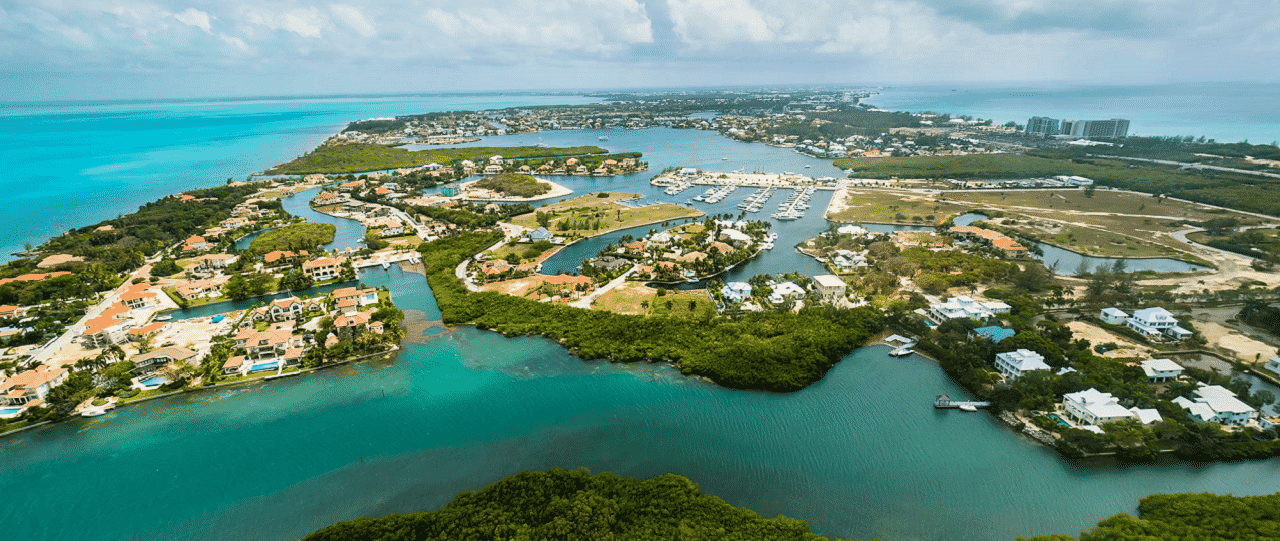 This is a picture of a luxury upscale suburb in the Cayman Islands, full of vacation homes for the rich who benefit from the low taxes in these offshore tax haven. On this page you can read about the casinos, licensed online casinos accepting players from the country.