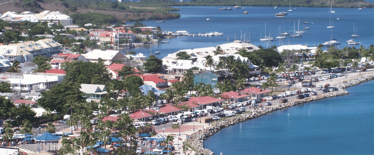 This is a picture of the beach, port and marina of Marigot, the capital of the Collectivity of Saint Martin (Collectivité de Saint-Martin). On this page, you can read about the legislation, rules, licensing, taxation of the various forms of games of chance and online gambling in the country, including: poker, bingo, lottery, sports betting, cryptocurrency wagering, and a list of online gambling sites which accept players from St. Martin.