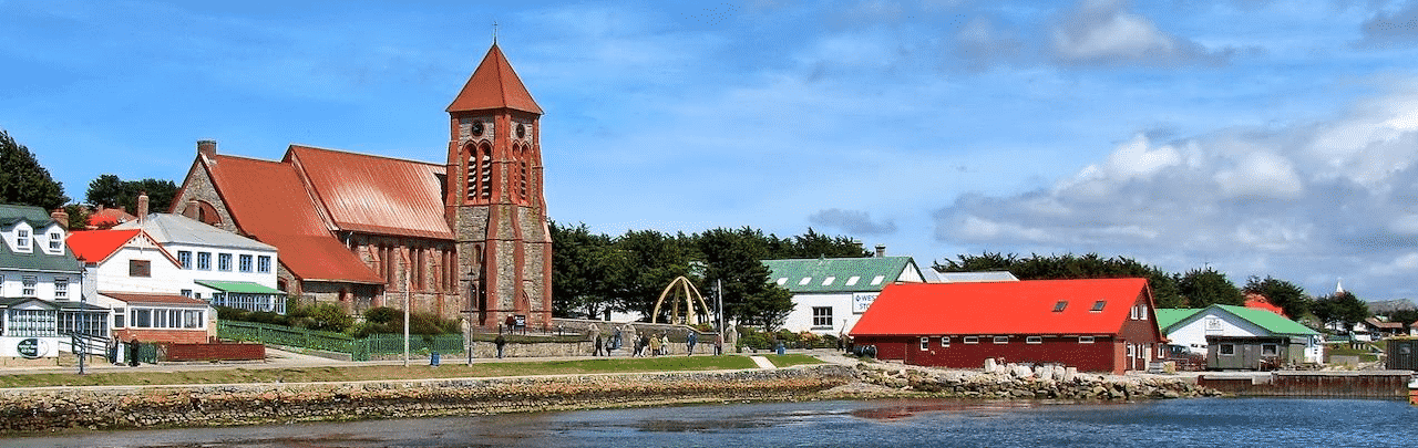 This is a picture of the skyline of Port Stanley, the capital and biggest city of the Falkland Islands. On this page you can read about the taxation, legislation, licensing of casino gambling in this British Overseas Territory, and you can find a list of licensed casino gambling establishments, slot halls and online casinos, which accept players from the Falkland Islands.