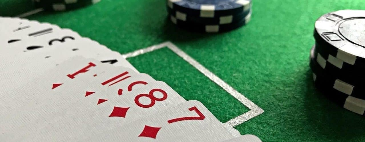 This a picture of playing cards and casino chips. This is the featured image on this blog post. Under this you can read about how to choose an online casino.